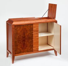 This Art Deco cabinet was designed for a puzzle collector and incorporates several puzzles and hidden details in the construction, it is the second in a growing series of mechanical furniture piece… Studio Furniture, Fine Furniture, Furniture Design, Secret Compartment, Puzzle Pieces, Traditional Design, Art Deco, Woodworking, Shelves