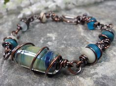 Shades of Blue - Artisan Lampwork and Solid Copper Wire Wrapped Bracelet by Patti Vanderbloemen, $45.00
