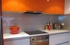 "Metaline Splashback in "" Silver Stream Perle "" what a great combination with the orange overhead cupboards - OzzieSplash, Building Construction, Central Mangrove, NSW, 2250 - TrueLocal"