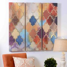 The Quatrefoil Panel Canvas Art Set combines bold colors with gold accents and features a unique three-piece design. This exciting piece is perfect for spring and would look wonderful in your living room, especially with the light reflecting off of its gold foil.