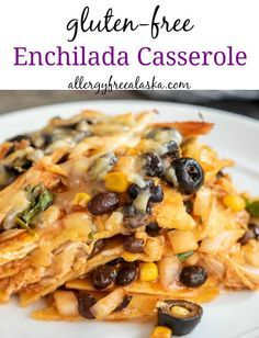 What I love about this gluten-free enchilada recipe is that it takes advantage of canned and precooked items (hello grocery store rotisserie chicken!). So you can put it together in a hurry yet still have a delicious hot meal ready in no time for your family. #healthychicken