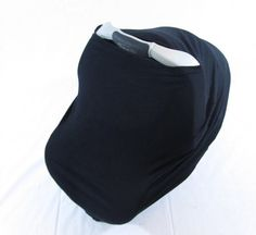 Simple and chic solid black car seat cover. Also doubles as a nursing cover. Less stuff to carry around in your diaper bag! Click through to see this, along with 100+ other designs in my Etsy shop!