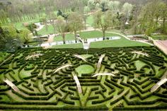 "CHÂTEAU DE THOIRY - Atout France Guide  Also called the ""Dream of Pophilo"". This maze was inspired by a 15th century book of the same name. The maze basic shape is a giant eye with a five pointed star as the ""iris"". Not shown in this picture, the edges form the shapes of an owl, dove, fish and lizard."