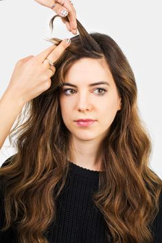 Can't deal with your bangs? Try a mini French twist (here, step 3 of creating it). See how to do it plus four other styles that will get your bangs out of your face chicly.