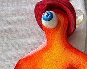 "Pendentif ""Cyclope"" orange"