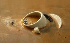 Coffee cup dropped in the coffee Wallpaper