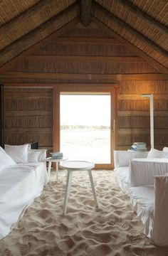 I'm not a huge fan of the blindingly white furniture but I do like the sand floor.