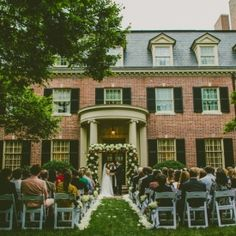 A traditional southern wedding in North Carolina's famed Carolina Inn includes an outdoor ceremony with a magnolia leaf arch.