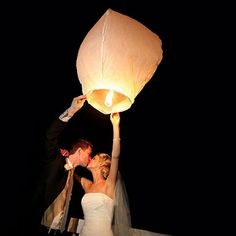 """Wish lanterns come from an Asian tradition various celebrations. Releasing them at a wedding symbolizes hopes and wishes of good luck for the future of the couple, and the floating away of worries and problems."""