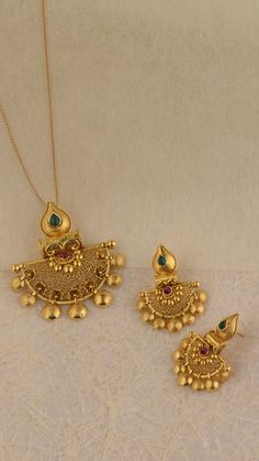 Explore the collection of the handcrafted gold and diamond pendant set which looks stunning with gold stud earrings and redefines beauty. Gold Earrings Models, Jewelry Design Earrings, Gold Earrings Designs, Gold Jewellery Design, Ear Jewelry, Necklace Designs, Pendant Jewelry, Jewelry Art, Jewelry Bracelets