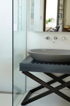 The project successfully showcases how modern design can draw on references of the past. The basin was custom designed...