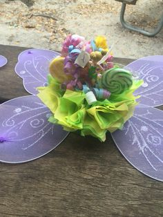 Centerpiece was made by Jacqueline Taylor and Nora we bought fairy wings for every little girl to become fairies