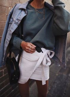 sweatshirt. wrap white skirt. denim jacket. street style.