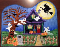 Isn't this beautiful! Exquisitely stitched by one of our customers, this A Collection of Designs halloween house really comes to life!!
