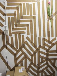 Different colored painters tape on the walls? Making tape abstract art. What is the risk of trying?!!