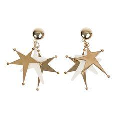 Marni earrings, $680, farfetch.com. -Wmag