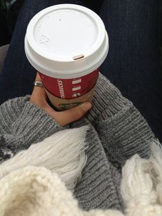 this is what winter is all about starbucks and cozy sweaters