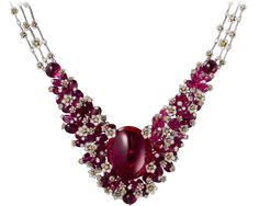 CARTIER. {Close up} Necklace - white gold, one 62.15-carat oval-shaped cabochon-cut rubellite, three cabochon-cut rubellites totaling 9.90 carats, rubellite beads, orange and white brilliant-cut diamonds.