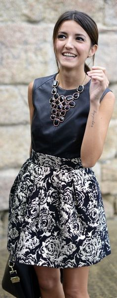 Beautiful leather shirt with a black and white floral skirt. Then it finished off with a black and gold necklace
