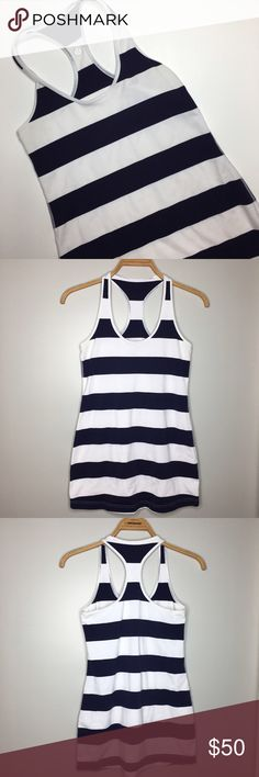 "Lululemon Striped Navy Blue and White Dress Great condition navy blue and white striped Lululemon dress. Size tag has been removed but I'm estimating a size medium. Bust: 30"", Length (armpit to bottom hem): 21"" lululemon athletica Dresses Mini"