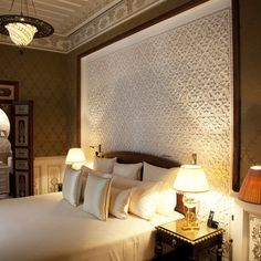 Love the white plaster design used behind the bed, great mixed with wood bed wall.