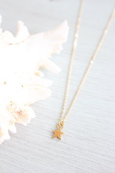 New to MoonTideJewellery on Etsy: Tiny gold star necklace - Little gold star necklace - Small gold star necklace - Gold star pendant - Space necklace - Tiny gold necklace (7.99 GBP)