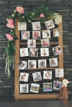 Baby photo display for a first birthday (via Deer Pearl Flower).
