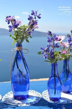 #centerpiece DIY Santorini Wedding |See the full post here:http://tietheknotsantorini.com/blog/diy-santorini-wedding-decor-blue-purple