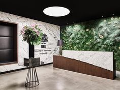 Mossy reception area at IBS Insurance Brokerage in Istanbul | design by Yigit Bileydi Architects @ybarchitects | photo by Ibrahim Ozbunar |…