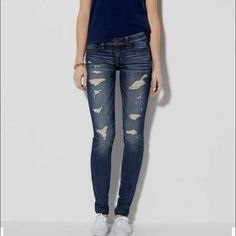 AEO Hi-Rise Destroyed & Sanded Jeggings American Eagle Outfitters High Rise medium wash destroyed & distressed Jeggings with ribbing & sanding. Size 0 Regular. Very soft & has super stretch. Please send reasonable offers through the offer button! American Eagle Outfitters Jeans Skinny