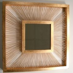 Unique DIY Picture Frames | Dig the unusual circle-punched pattern of Treecycle's Mirror .