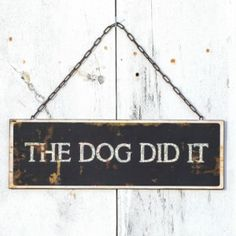 "Hanging Metal ""The Dog Did It"" Sign"