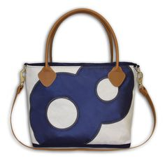The perfect fusion of beach bag and strappy, everyday purse-made of recycled sailcloth and leather detailing.