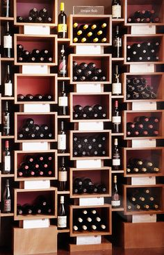 create wine display screen behind the hostess stand (enclose with glass on either side)