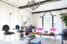 A modern meets traditional living room with vibrant pops of pink