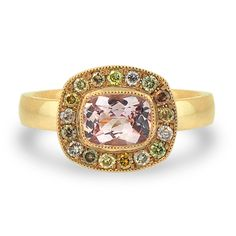 Pink Sapphire Halo Ring    14k yellow gold pink sapphire halo engagment ring with accent champagne coloured diamonds     $3800