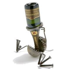 "oh my gosh. this is adorable! handmade  from recycled metal ""wine b gone bottle holder!"""