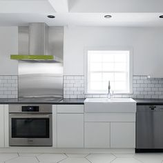 White Kitchen Open Shelves Hexagon Floor Tile Subway Tile, Stainless Steel  Appliences, Green Accent