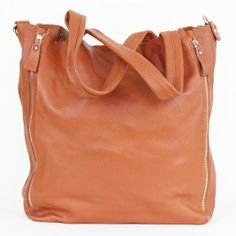 This bag has everything! Lovely leather, zipper details, and plenty of storage. www.mooreaseal.com