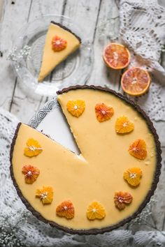 One of the best flavor pairings - dried figs and orange in a perfect Valentine's day dessert - a decadent dried fig and blood orange tart. Simple chocolate tart crust is holding a dried fig jam and a zesty blood orange curd, which is decorated with tiny o