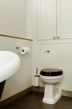 When you opt for a concealed cistern like this one – where pipework is hidden behind the wall, leaving only the bowl of the WC on show – avoid wasting space with built-in storage. Hidden Toilet, Toilet Cistern, Concealed Cistern, Group Of Companies, Fulham, Family Bathroom, Built In Storage, London, Shower