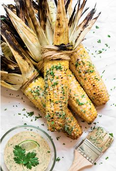 Grilled corn with piquant sauce.  <It's amazing!  Best thing you could possibly make for a cookout!