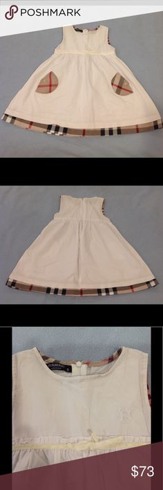"Burberry Dress Excellent condition Burberry Dress. Has the iconic plaid on the pockets and lining, a cream ribbon across the middle, and the Burberry ""B"" on the chest. There are 3 very small spots on the neck line and a tiny mark on the back of the dress that might be pen. Size is a 9 but it fits more like a 4/5. Burberry Dresses"