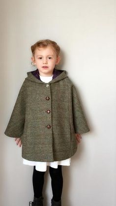 The 'Iris' cape is a luxury traditional hooded garment made in harris tweeds and rich wools and is fully lined. It fastens at the front with one beautiful vintage button and 3 leather style buttons.   With every thoughtful detail made to capture the imagination of little girls and the young at heart. posy&pearls designs are influenced by my favourite childhood dresses and the dreamy magical memories of childhood movies, think Chitty Chitty Bang Bang and Mary Poppins to name a ... Dress With Shawl, Vintage Buttons, Pearl Design, Stylish Girl, Girls Shopping, Wool Cape, Designer Kids Clothes, Tartan, Harris Tweed