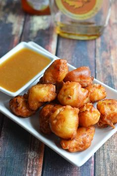 Maple Waffle Chicken Nuggets.  These chicken nuggets are coated in maple-y waffle batter and served with a honey maple mustard dip.  Perfect for parties or game day! | blog.hostthetoast.com