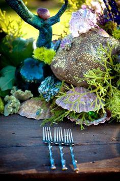 Wedding decor - I'm loving the idea of glittered rocks and iridescent orbs for a fairy theme!