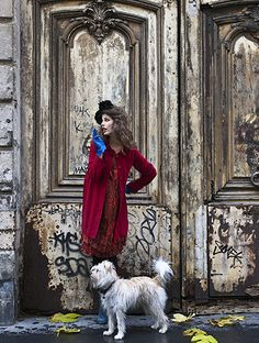 How cool to just walk around an ancient city in a red velvet coat with a random dog at my side!