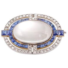 Cartier, Art Deco, Moonstone, Diamond, Sapphire Brooch, circa 1930   From a unique collection of vintage brooches at https://www.1stdibs.com/jewelry/brooches/brooches/