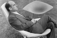 Haryy Bertoia lounging in his Bird Chair