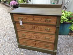 Spoon carved dresser painted with Annie Sloan Chalk Paint in Olive and sealed with Dark Wax.